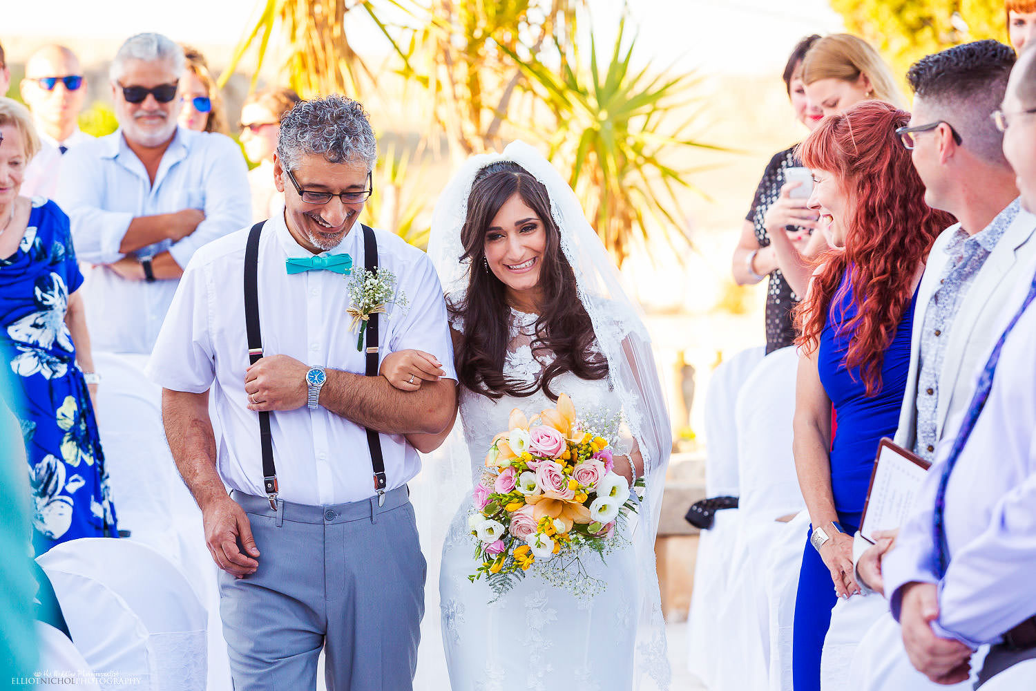 bride procession with her father at her wedding ceremony at the Olive Gardens, malta