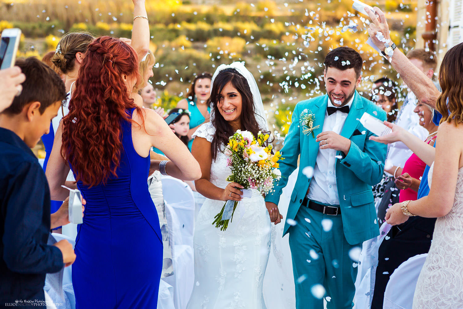 bride and groom walk down the aisle at the Olive Gardens, Malta.