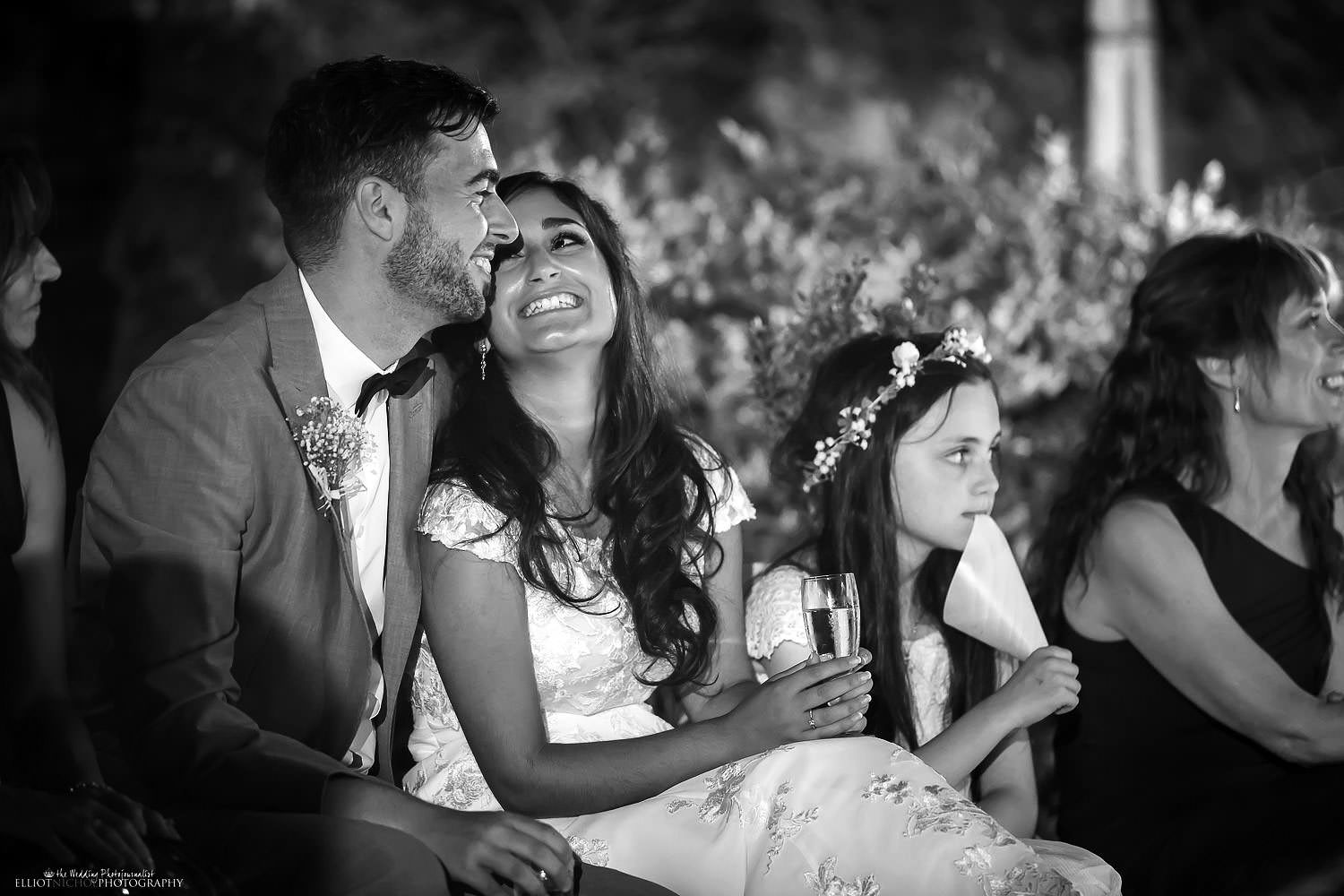 bride and grooms reaction during the wedding speeches