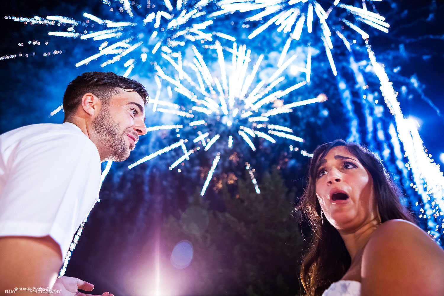 bride and groom's reaction to some surprise fireworks at the Olive Gardens, Mdina, Malta