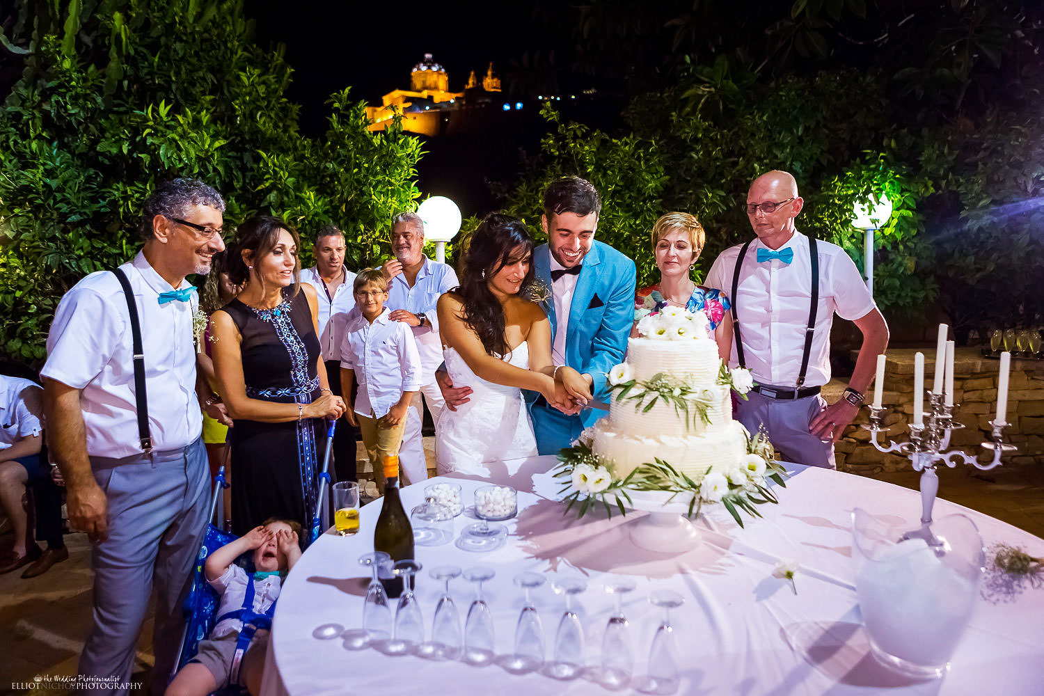 Bride and groom cut thier cake at the Olive Gardens, Malta.