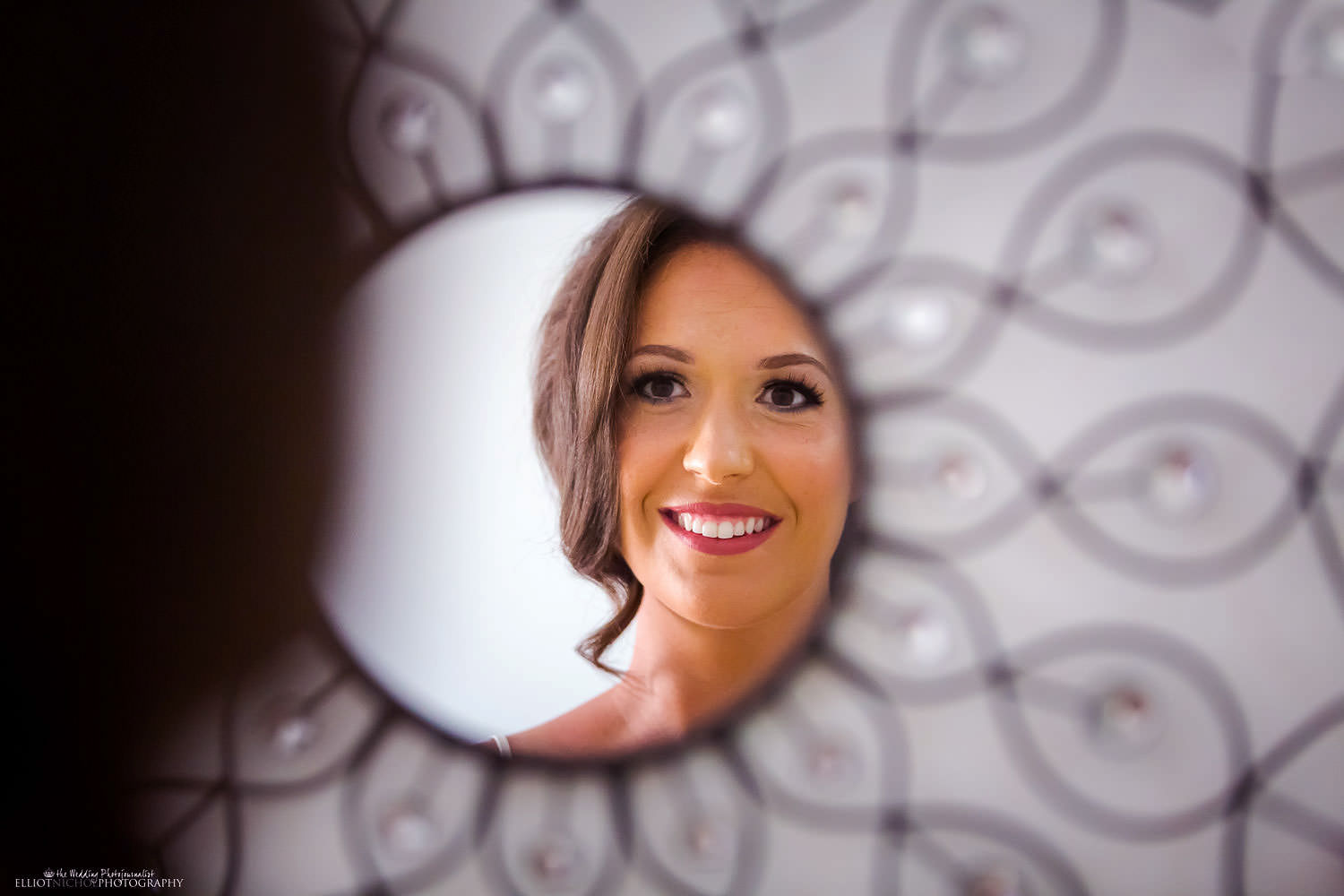 reflection of bride in mirror while she gets ready