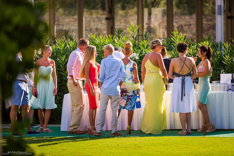 wedding guests at the bar at Villa Bologna.