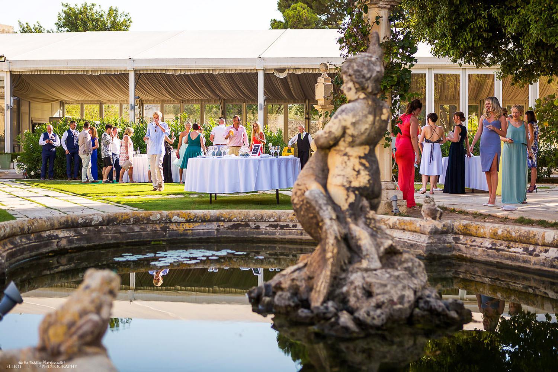wedding guests in the garden grounds of the wedding venue Villa Bologna, Malta.
