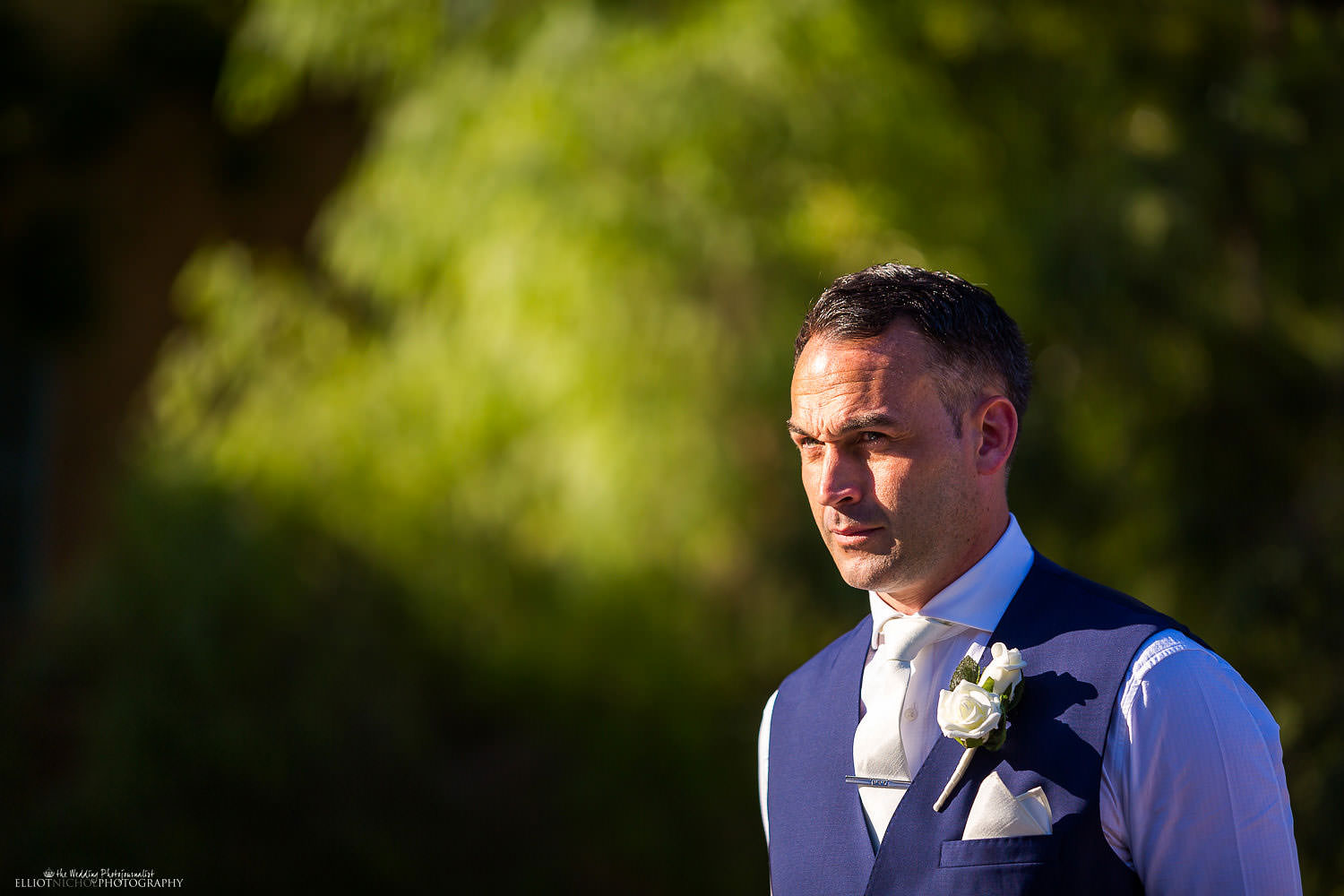 Groom waits for his bride to arrive in the Baroque Gardens at Villa Bologna, Malta.