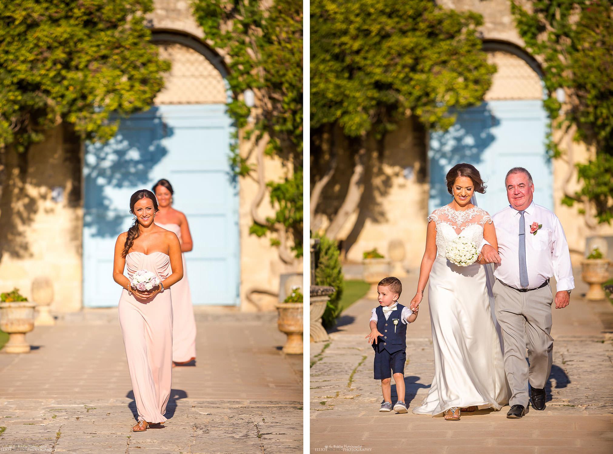 Bridal party make their procession to the wedding ceremony in the Baroque gardens at Villa Bologna., Malta.