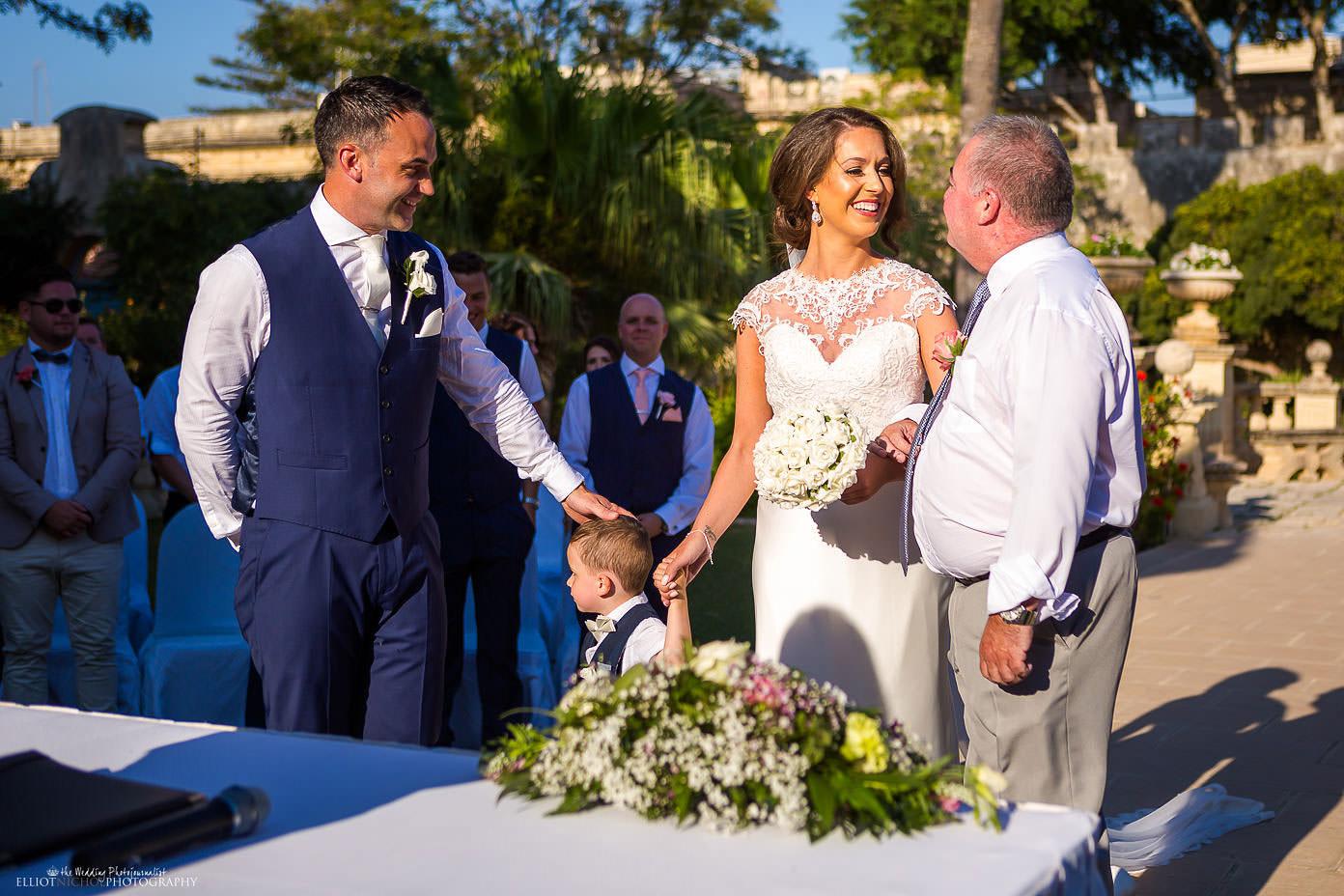 Bride meets her groom at their destination wedding ceremony in Malta.