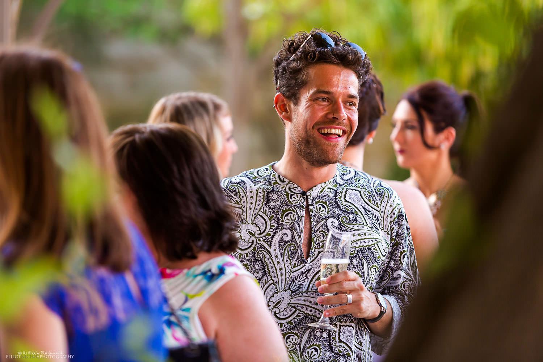 wedding guest enjoying the reception party in the gardens of Villa Bologna, Malta.