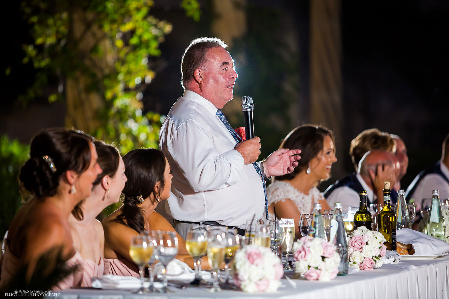 father of the bride makes his wedding reception speech.