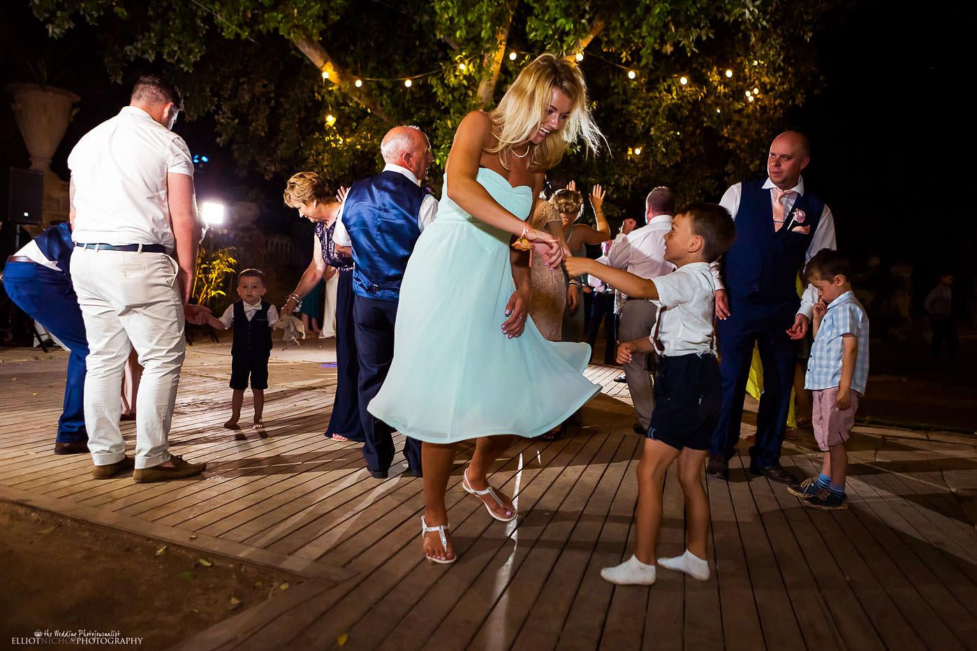 Dancing his the Villa Bologna's gardens during a wedding reception.