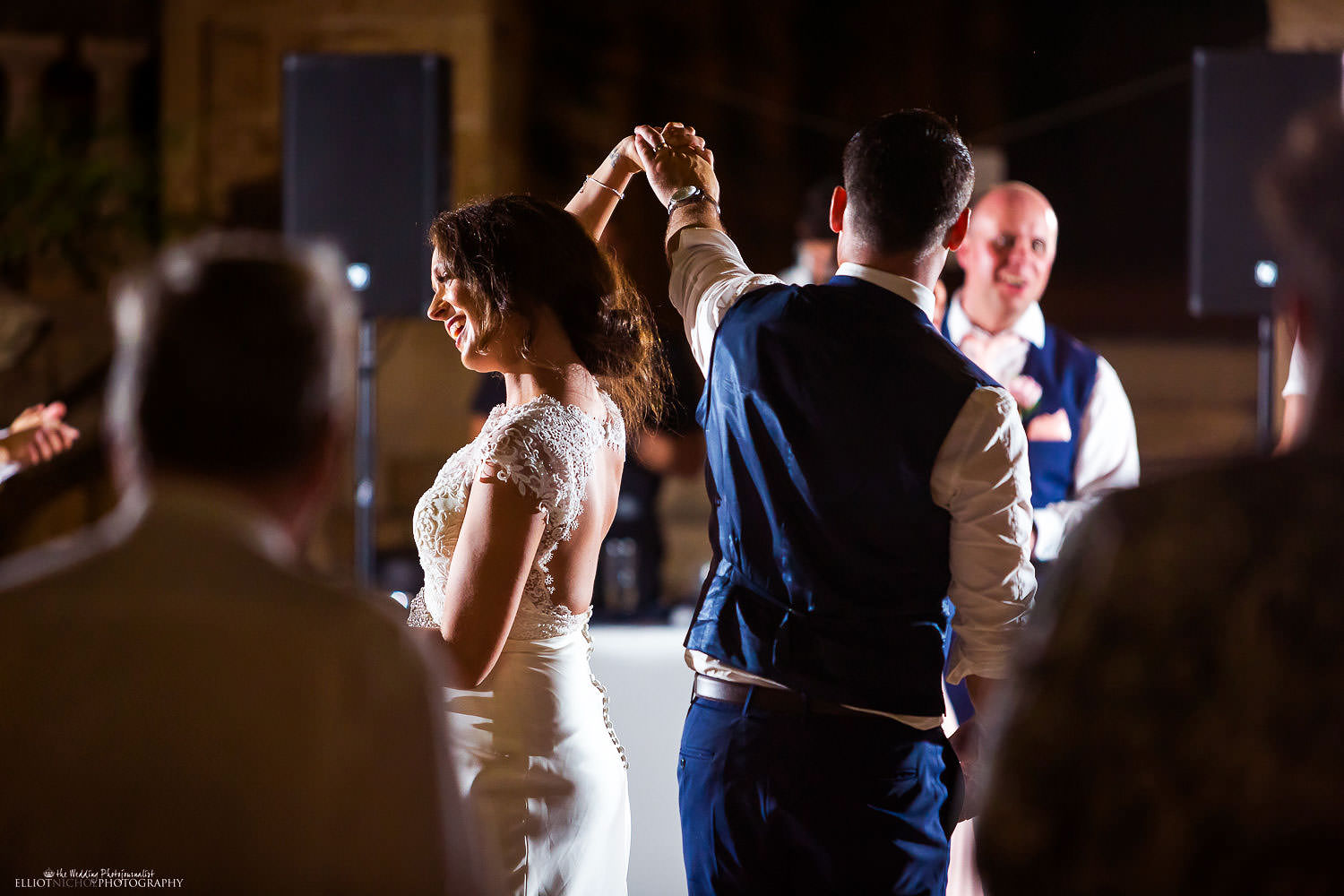 Bride and groom take their first dance in the gardens of Villa Bologna, Malta.