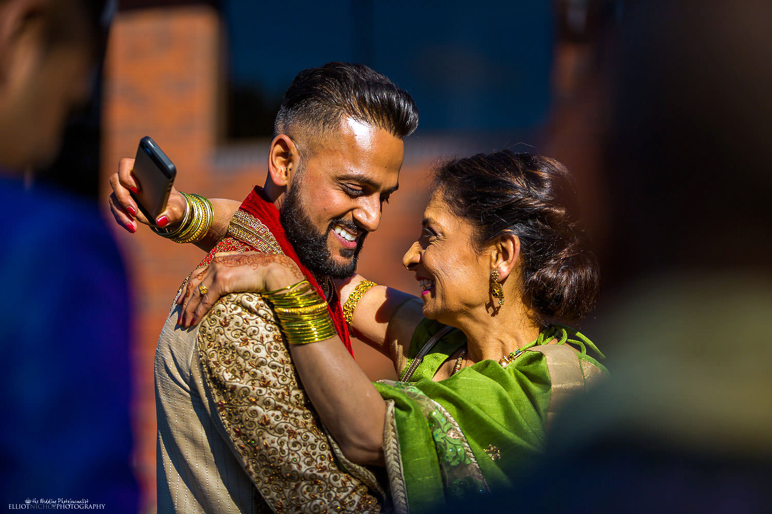 Indian Groom meets his mother-in-law to be. Photo by Newcastle Upon Tyne based wedding photojournalist Elliot Nichol.