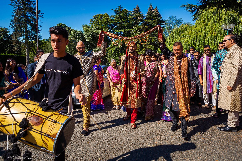 Indian groom's procession to his Hindu wedding ceremony location. Photo by Newcastle Upon Tyne based wedding photojournalist Elliot Nichol.