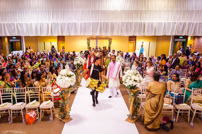 The grooms wedding procession arrives at the Hindu wedding ceremony. Photo by Newcastle Upon Tyne based wedding photojournalist Elliot Nichol.