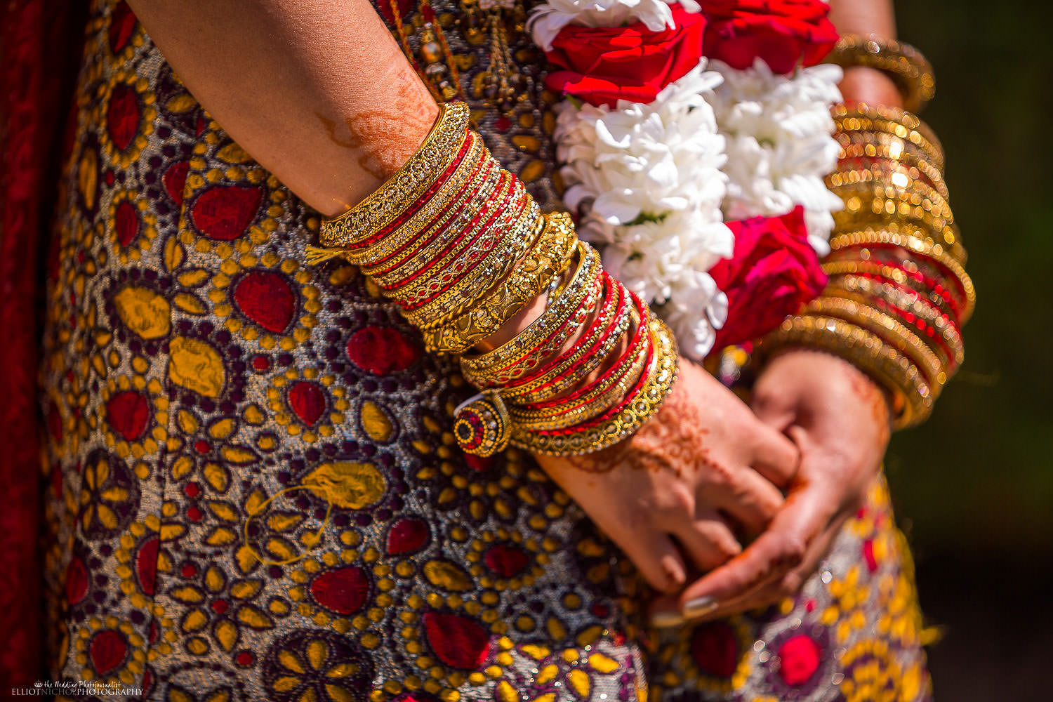 Detail of a Indian Brides dress and jewellery after her Hindu wedding ceremony. Photo by Newcastle Upon Tyne based wedding photojournalist Elliot Nichol.