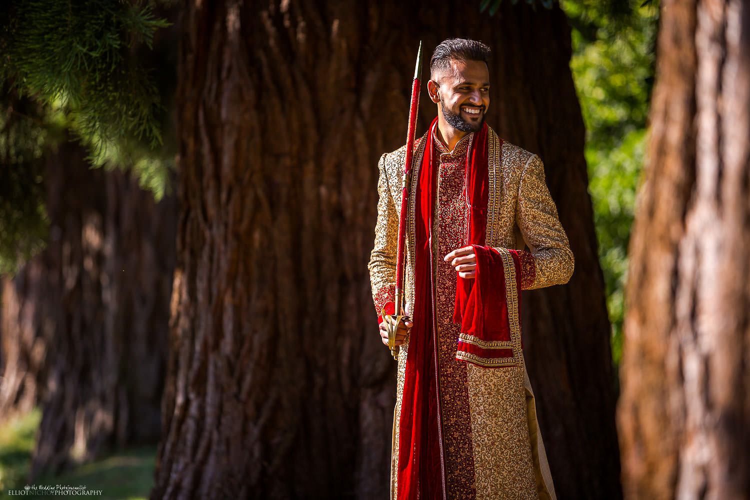 Portrait of Indian Groom in the grounds of Chateau Impney, England. Photo by North East based wedding photographer Elliot Nichol.
