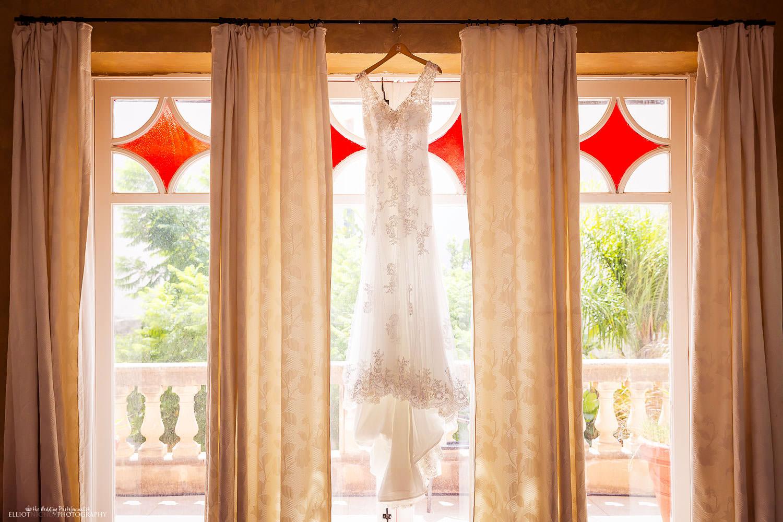 Destination brides wedding dress hanging in her wedding accommodation in Malta.