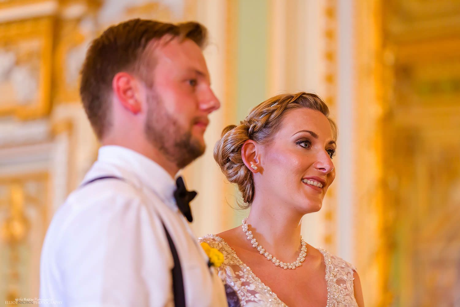 Bride and groom during their wedding ceremony at the Palazzo Parisio.