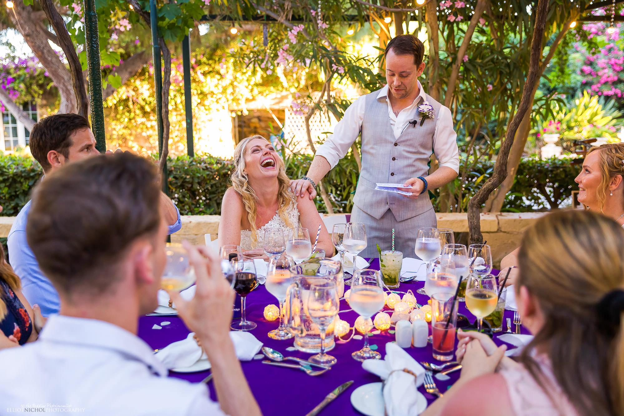 bride-laughing-husband-speech-wedding-reception-weddings-destination-UK