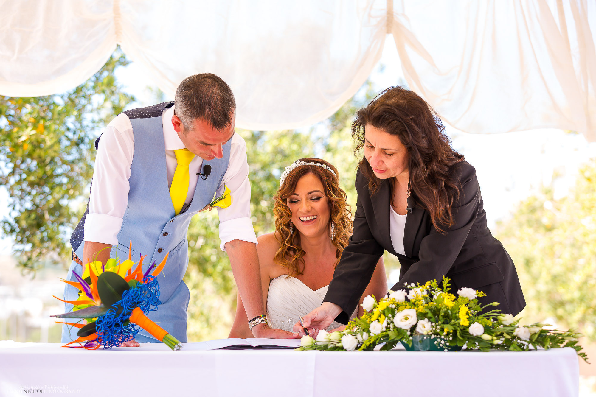 registrar-signing-marriage-certificate-destination-wedding