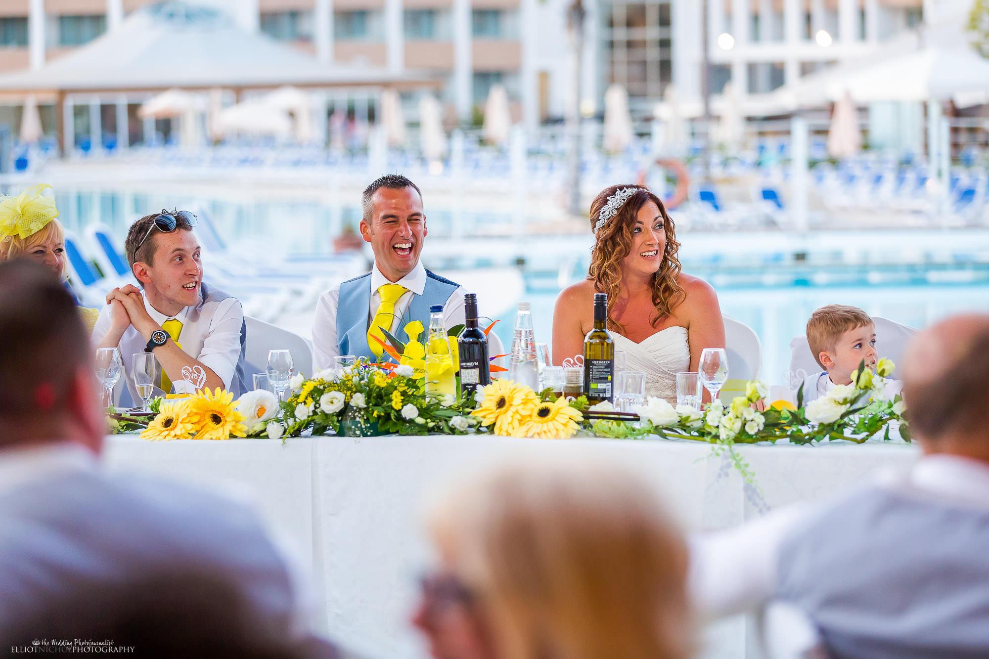 groom-laughing-wedding-reception-speech-best-man