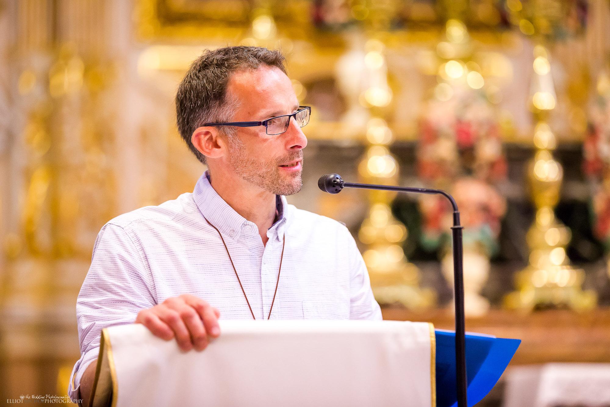 wedding-guest-reading-church-ceremony-destination-weddings