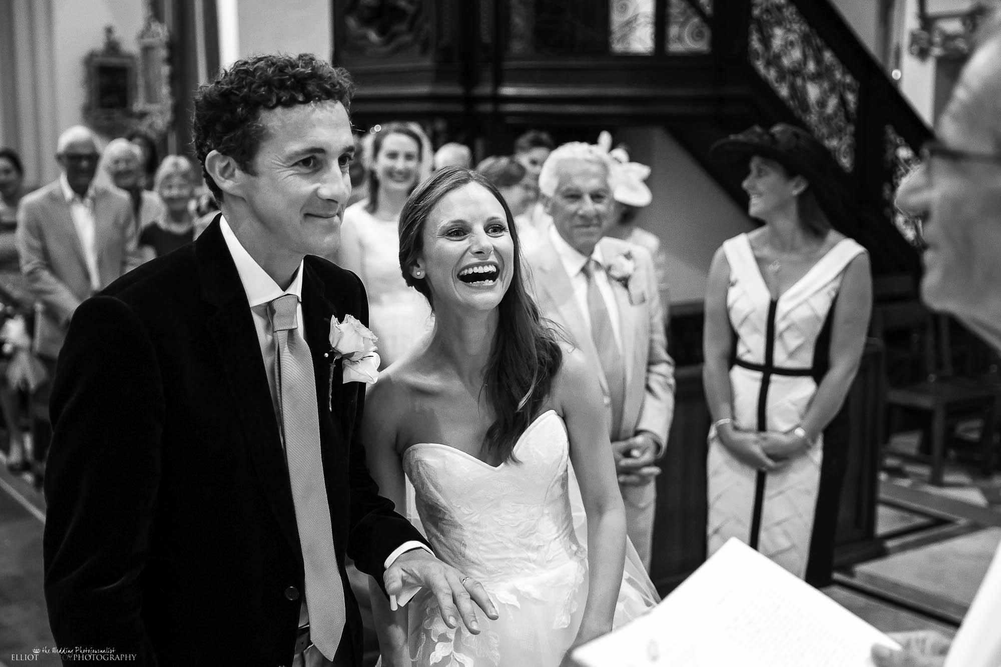 wedding-bride-groom-laughing-church-photography
