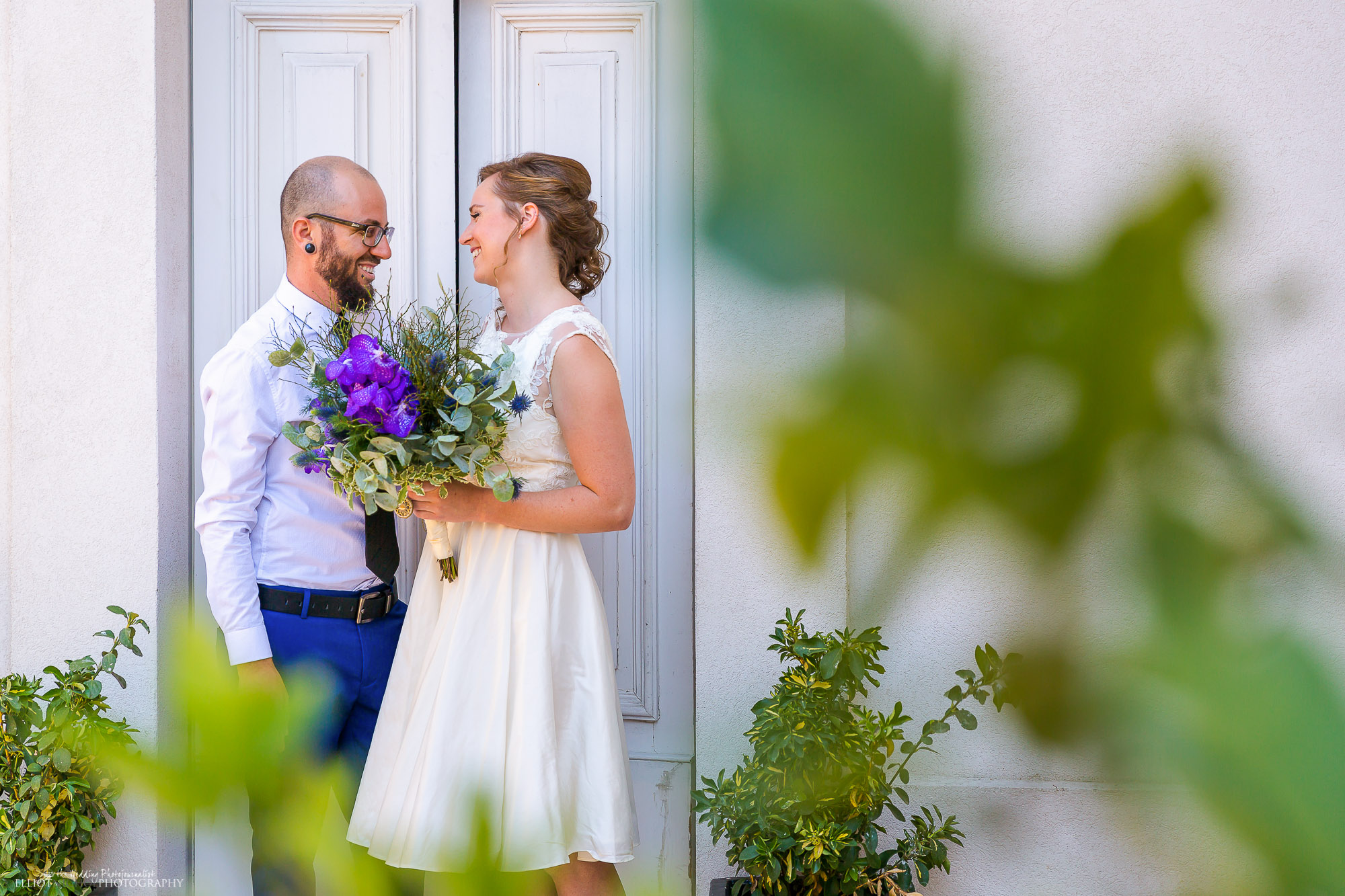 Groom collects his bride to go to their destination wedding blessing.