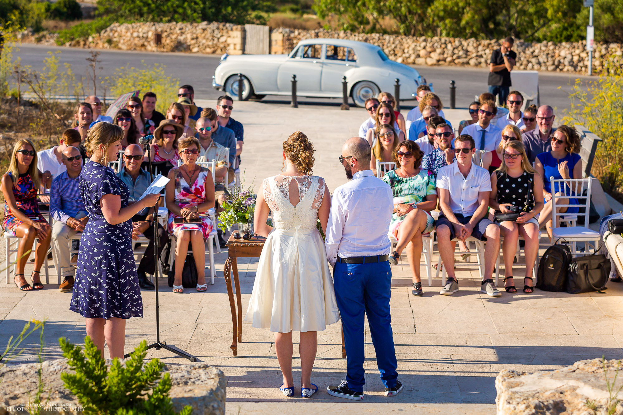 Wedding guest reading during the wedding blessing ceremony. North East and destination wedding photographer Elliot Nichol.