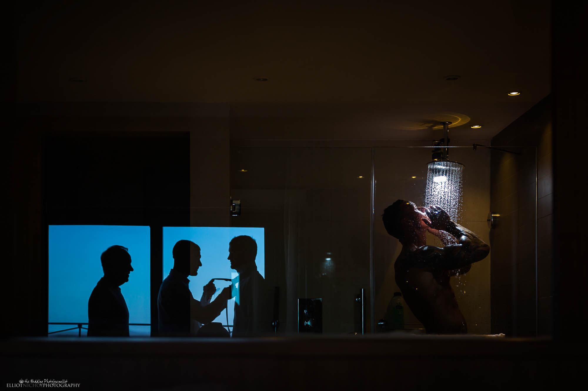 Showering Groom from Bexleyheath in Kent getting ready with his Groomsmen on his wedding day. Newcastle Upon Tyne based wedding photographer Elliot Nichol.