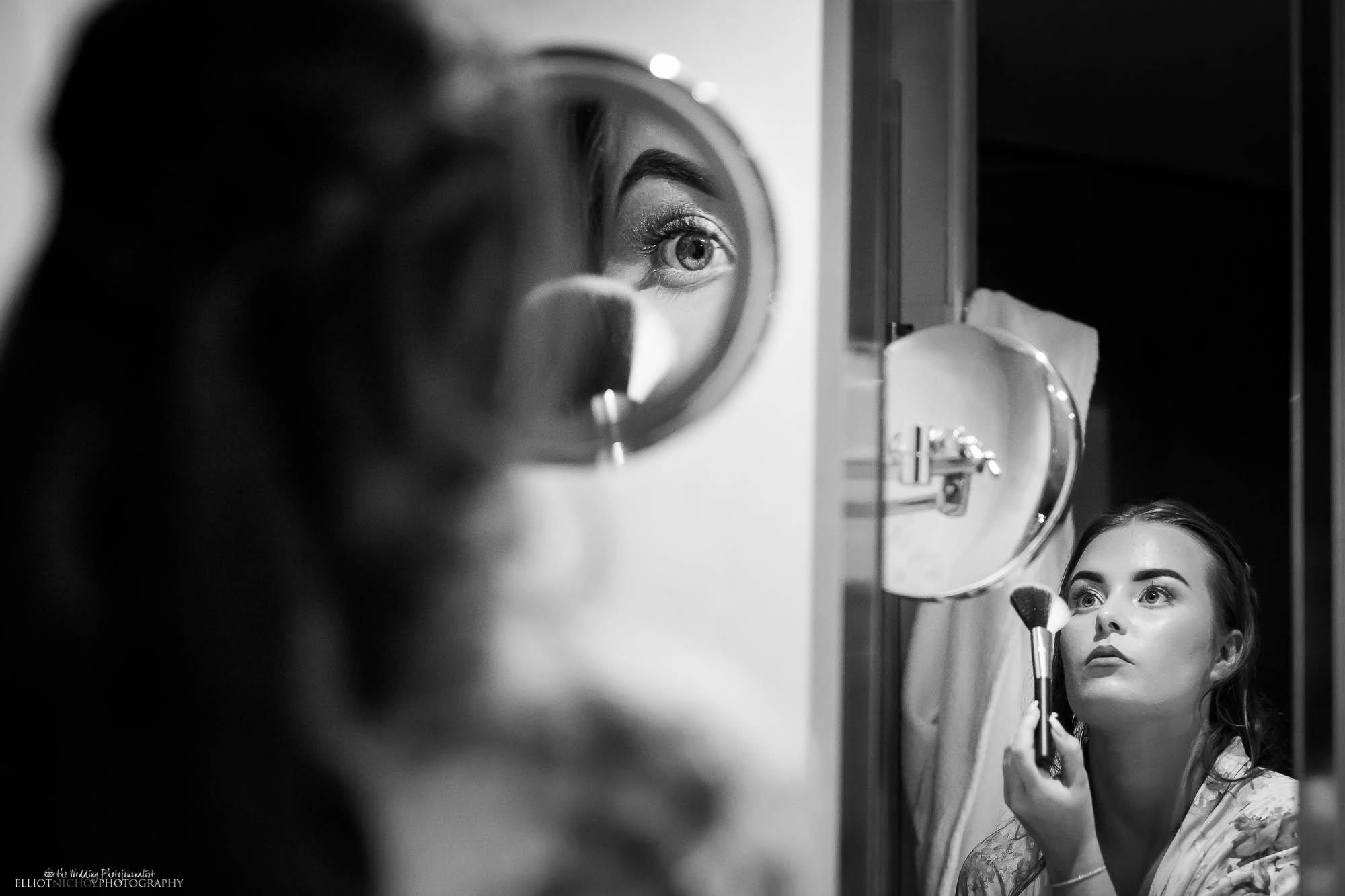 creative wedding photography. Bridesmaid putting on her makeup on the morning of the wedding.