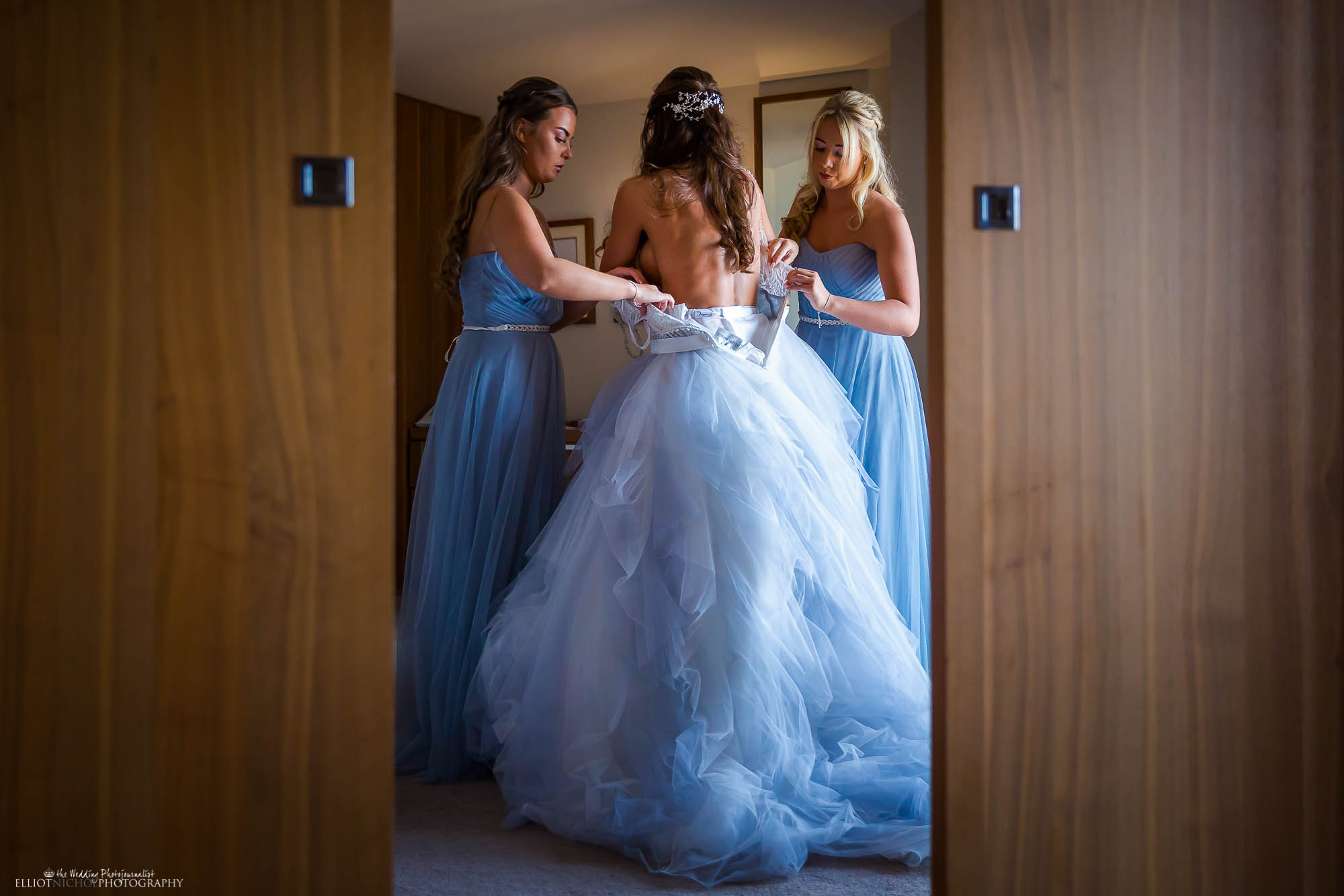 Bridal partying getting ready in their blue wedding dresses. Northeast wedding photography.