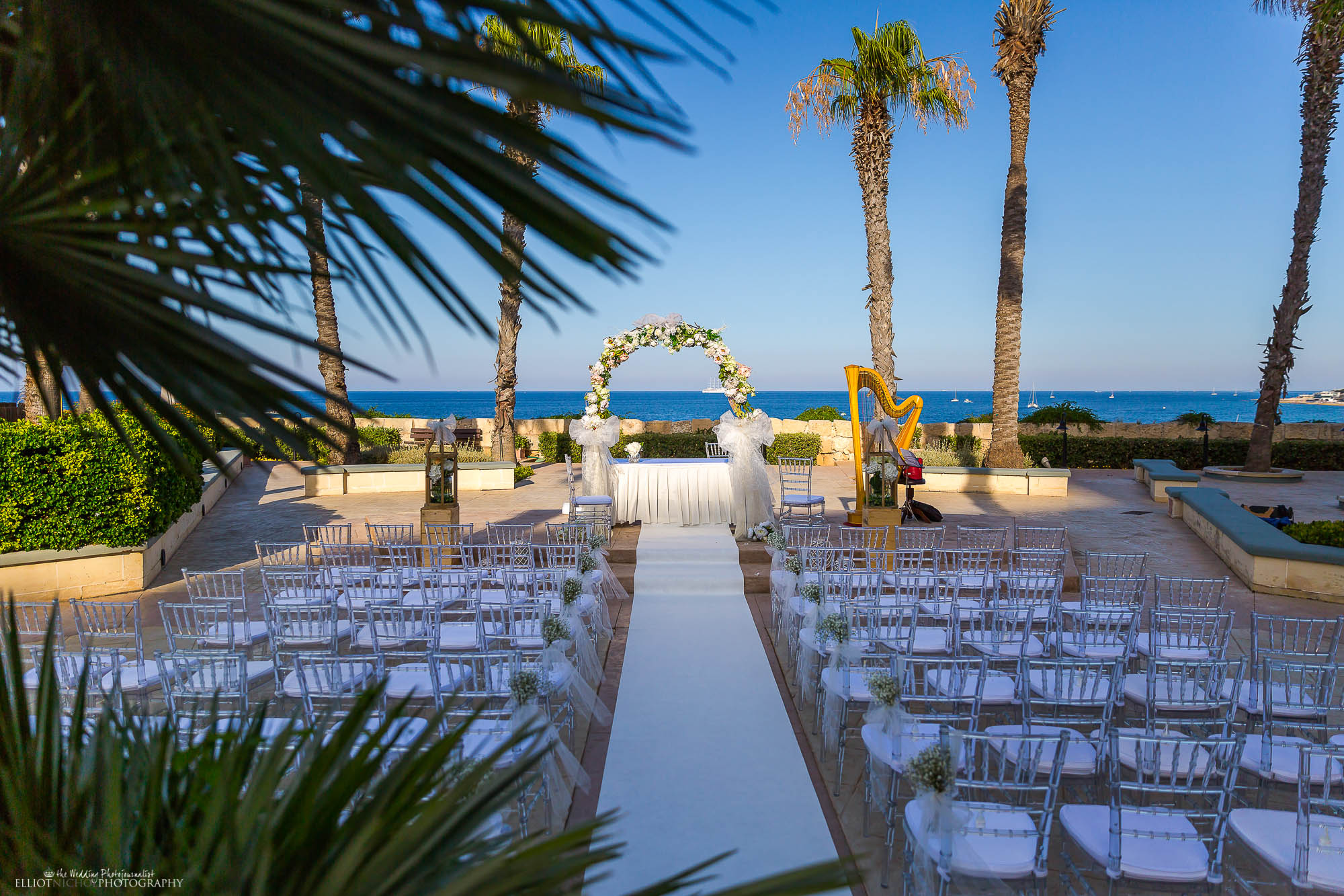 Destination wedding ceremony setup under the palm tree's and by the sea