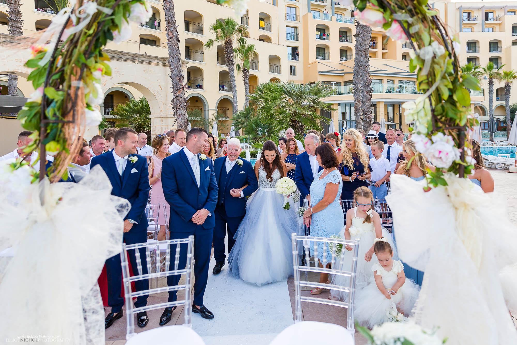 Bride arrives at her destination wedding ceremony in her blue wedding dress.