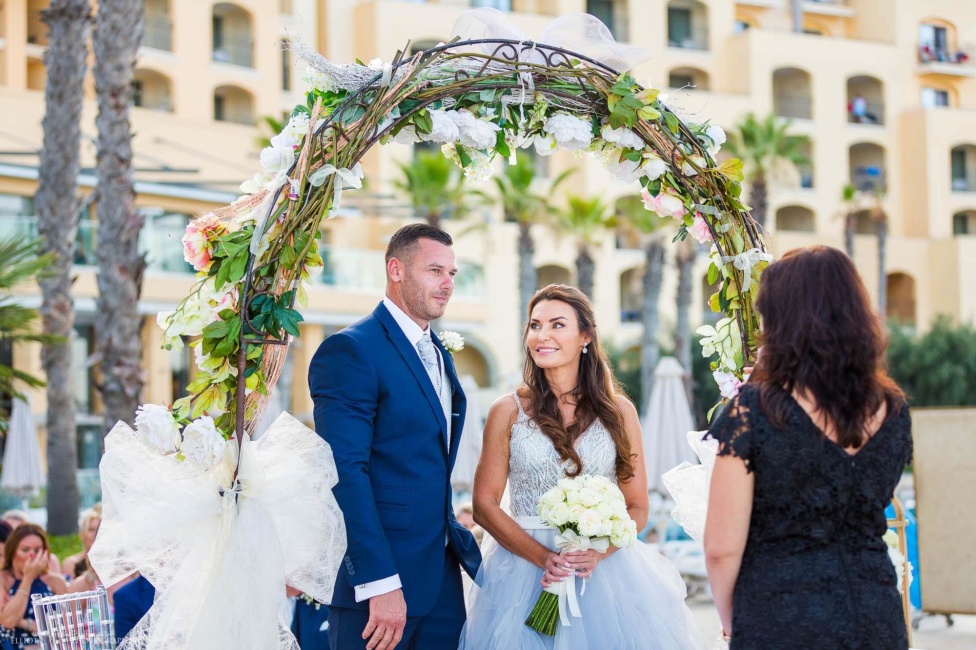 Bride and groom during their destination wedding ceremony. Elliot Nichol Photography.