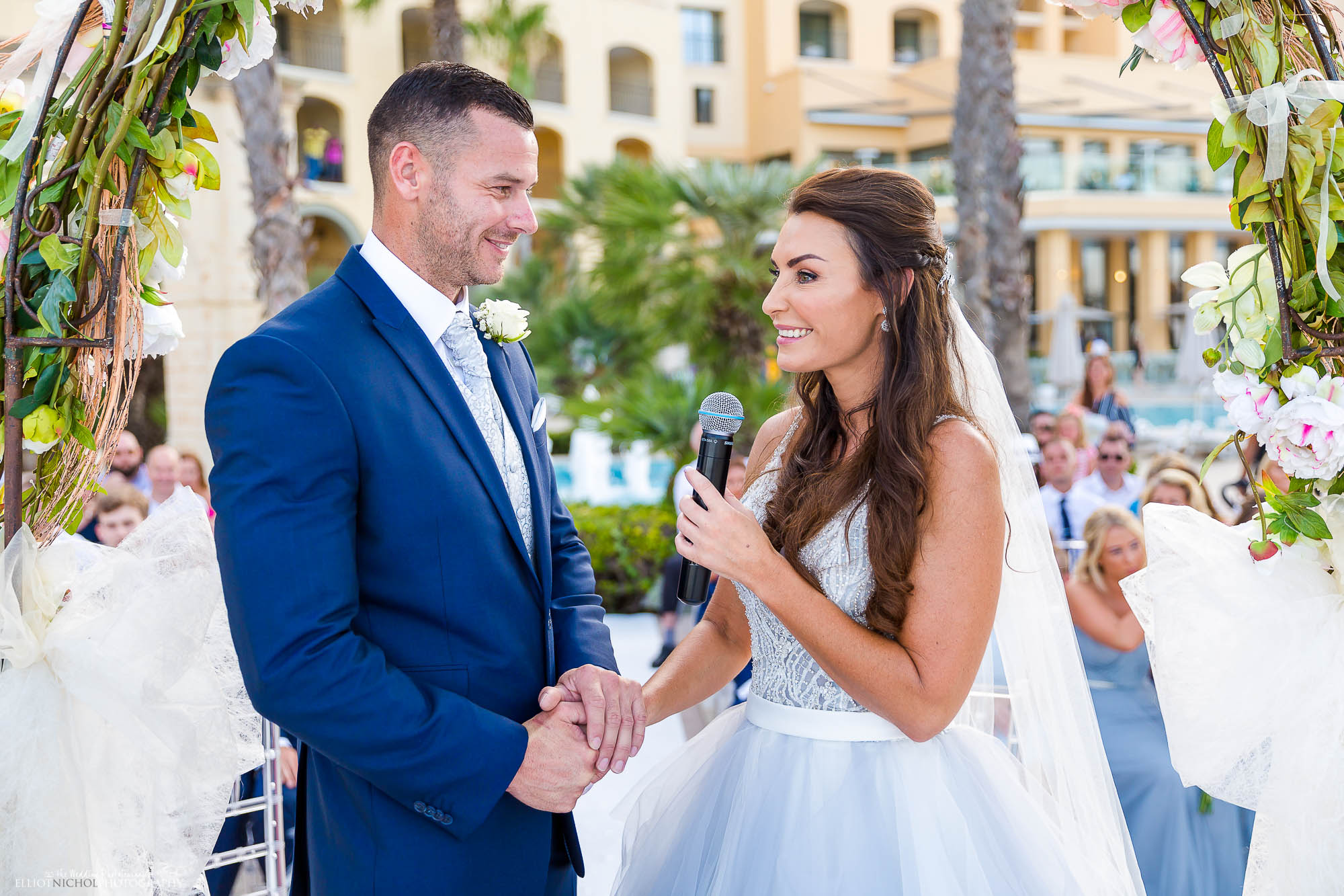 Bride says her vows during her destination wedding civil ceremony. Wedding photography by Elliot Nichol.