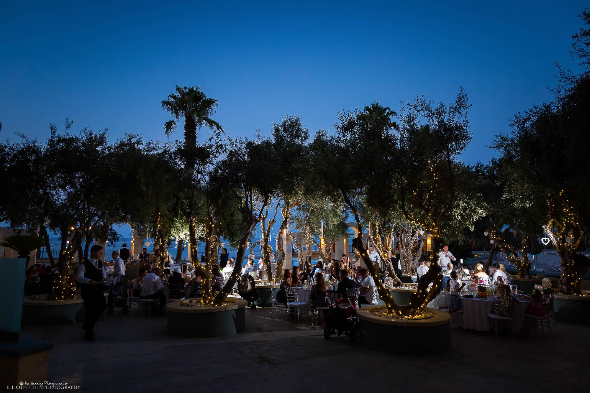 destination wedding's reception setup under olive trees.