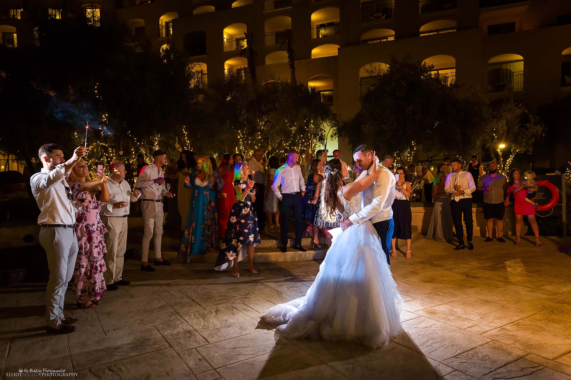 Bride and groom from Kent, UK, take their first dance during their destination wedding recperion party.