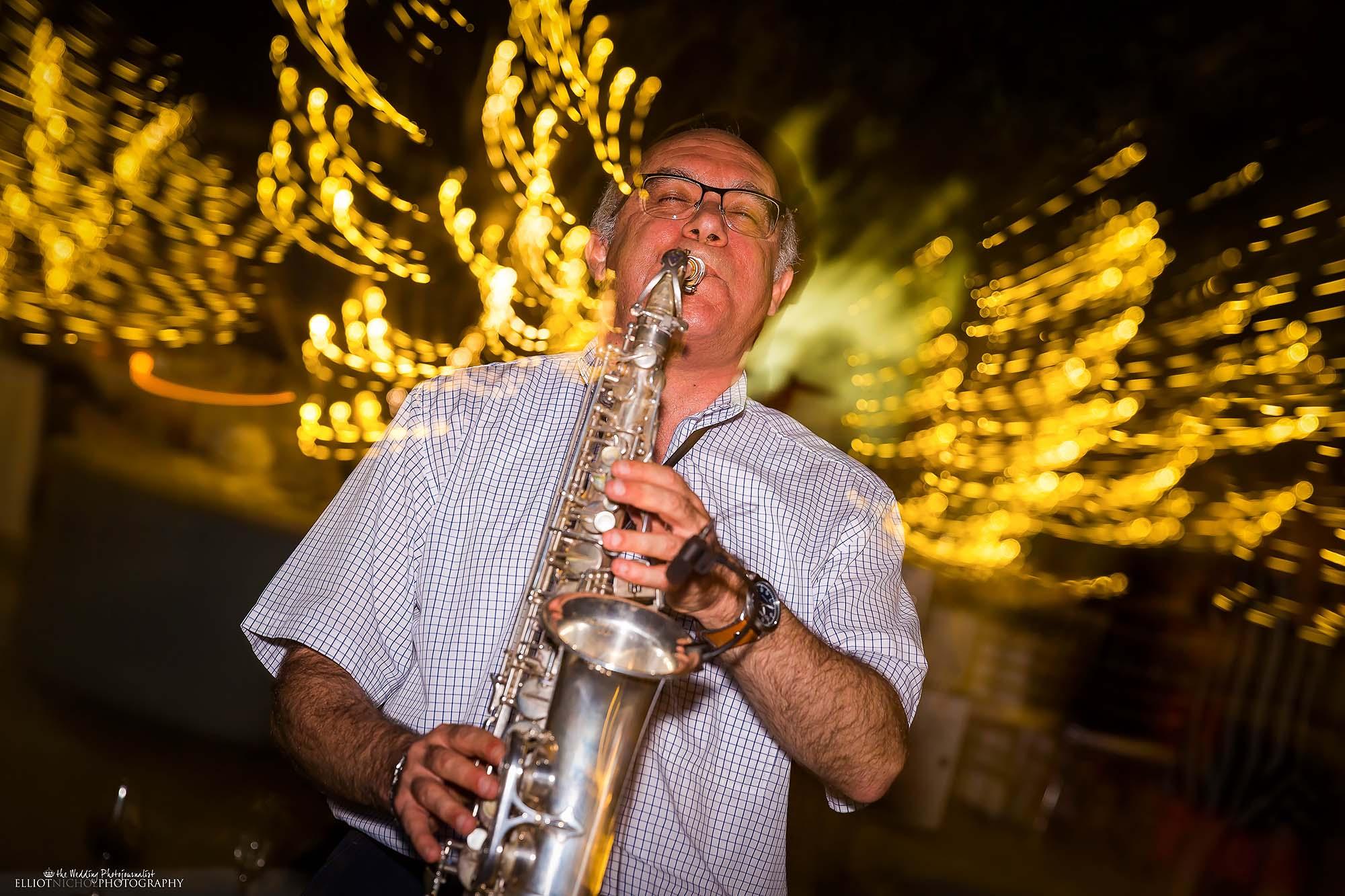 Wedding musician plays his Sax during the wedding reception. Photo by North East wedding photographer Elliot Nichol.