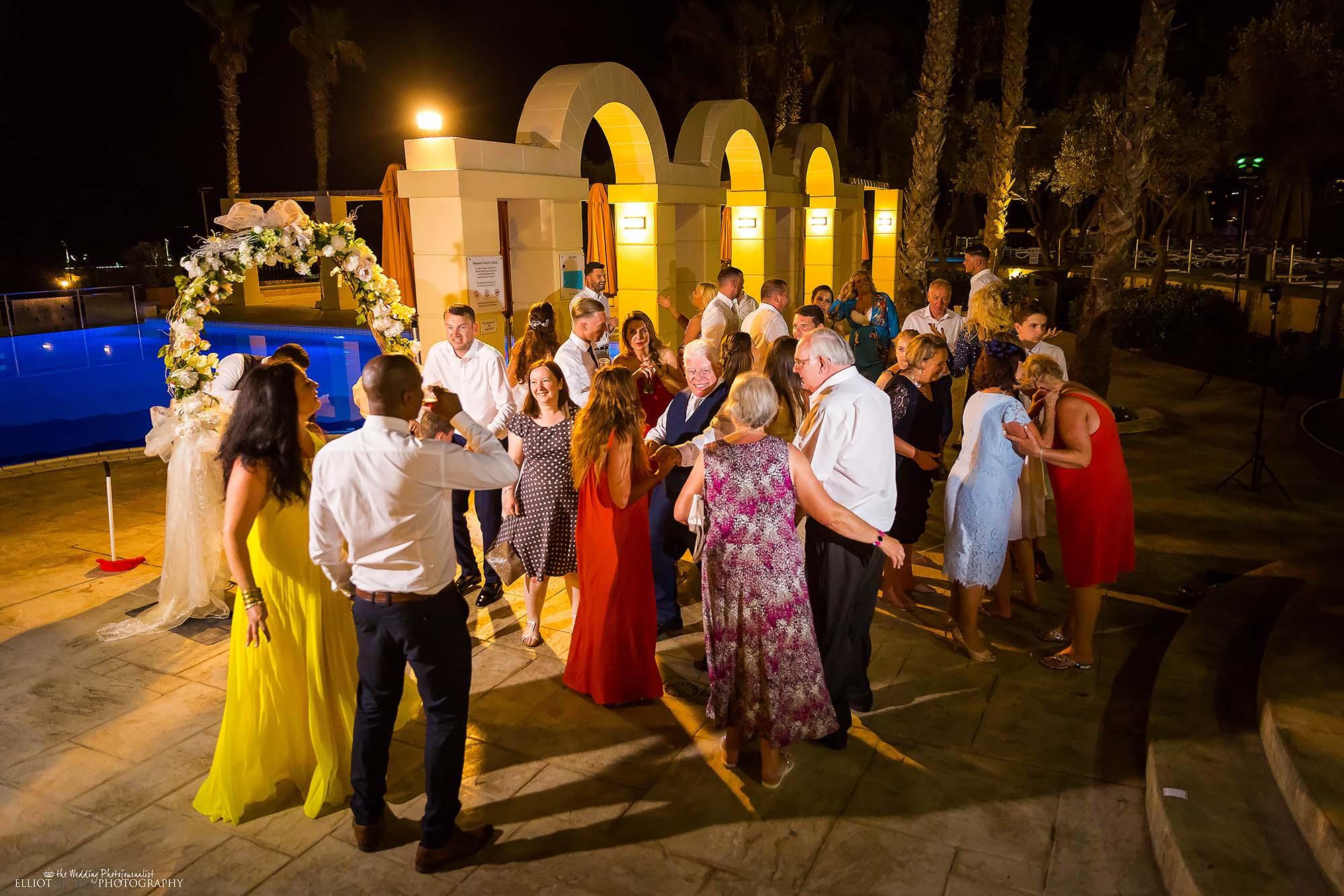 Destination wedding guests on the dance floor.