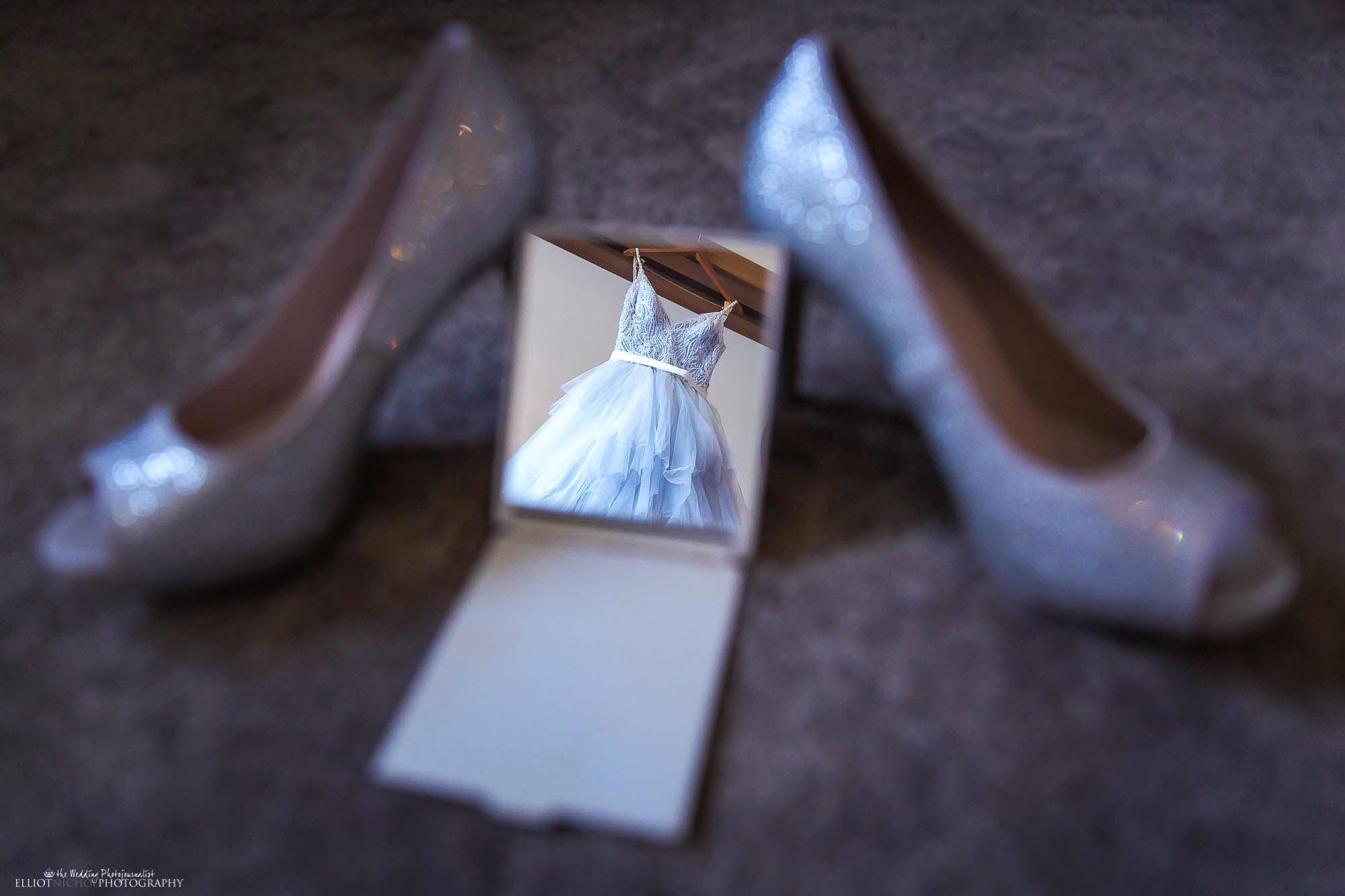 Brides blue wedding dress reflected in a hand mirror. Creative wedding photography by North East wedding photographer Elliot Nichol.