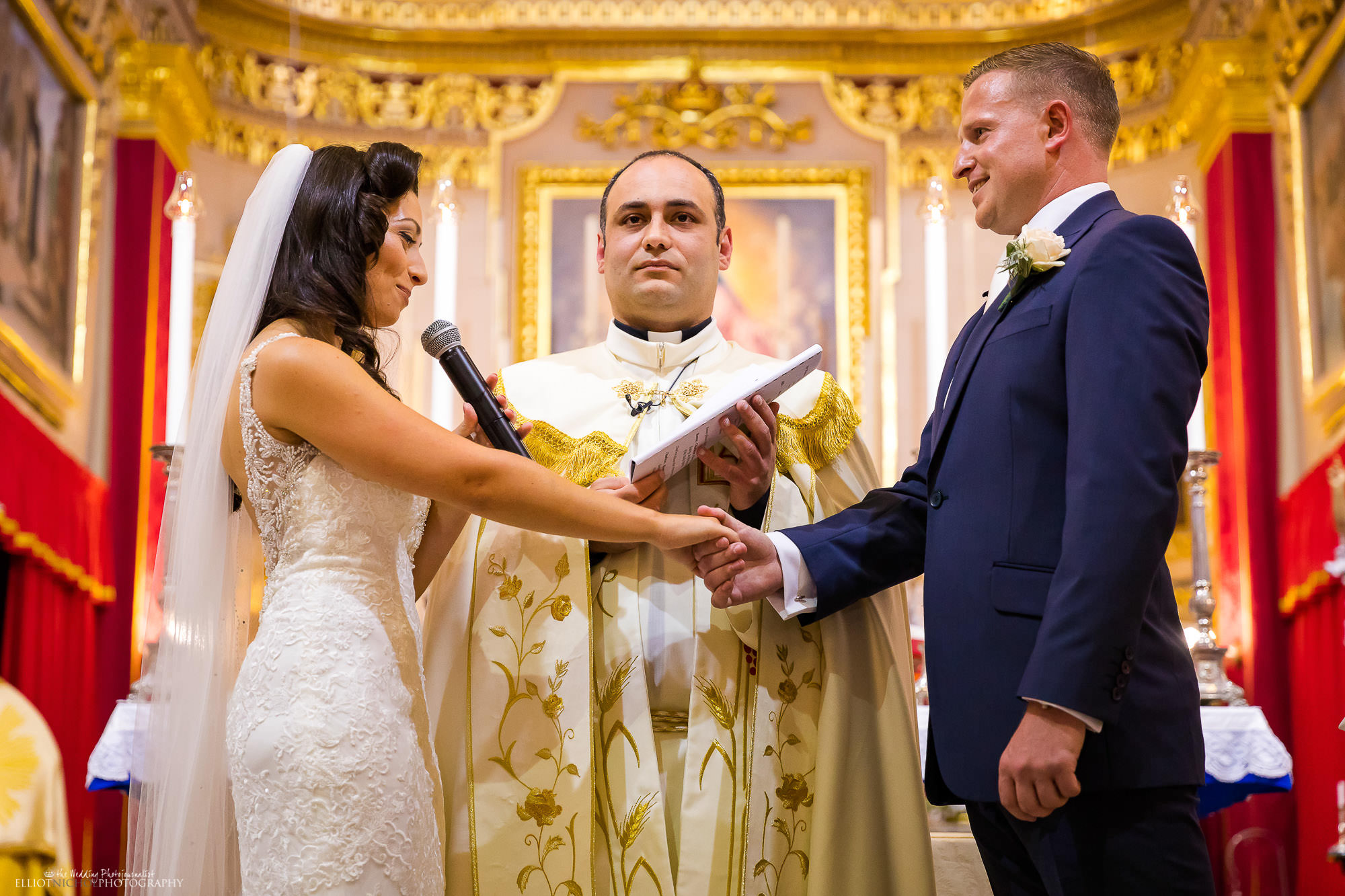 bride-groom-priest-reading-vows-wedding-ceremony-church