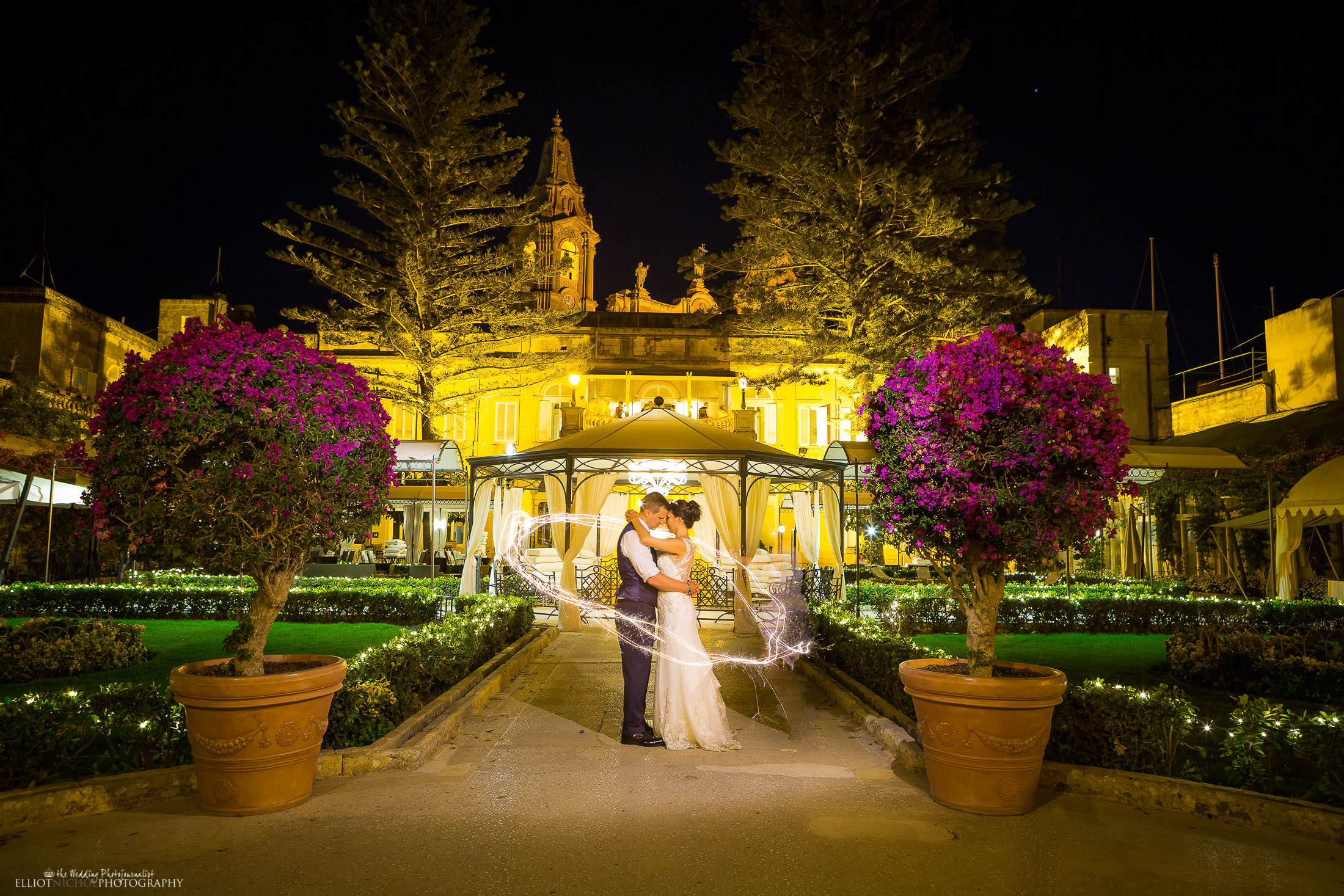 Bride and groom's midnight portrait in the gardens of their destination wedding venue. Photo by Elliot Nichol Photography.