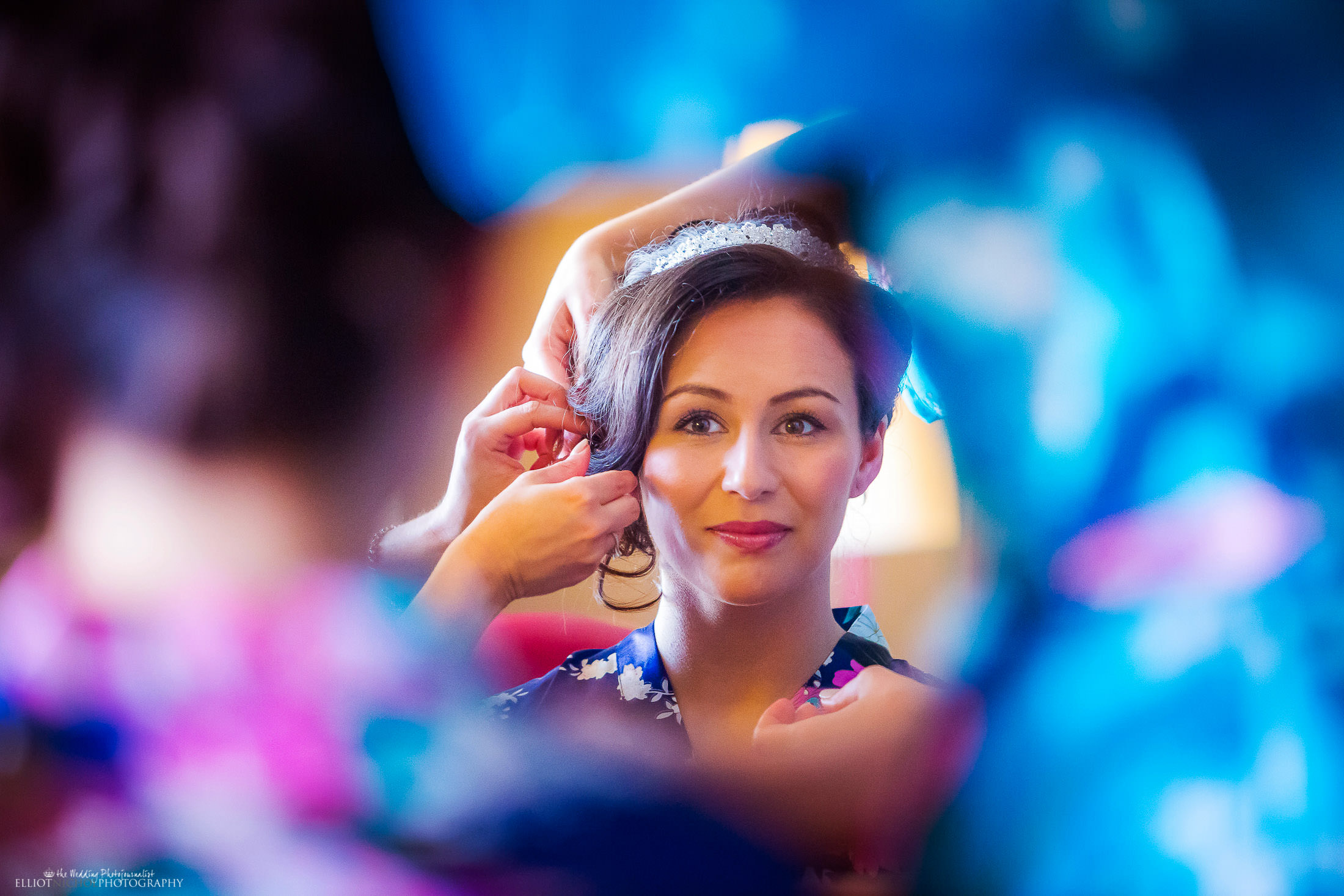 Bride gets ready with the help of her bridesmaids. Photo by Elliot Nichol Photography. Based in the NE but covering the whole of the UK and EU destination weddings.