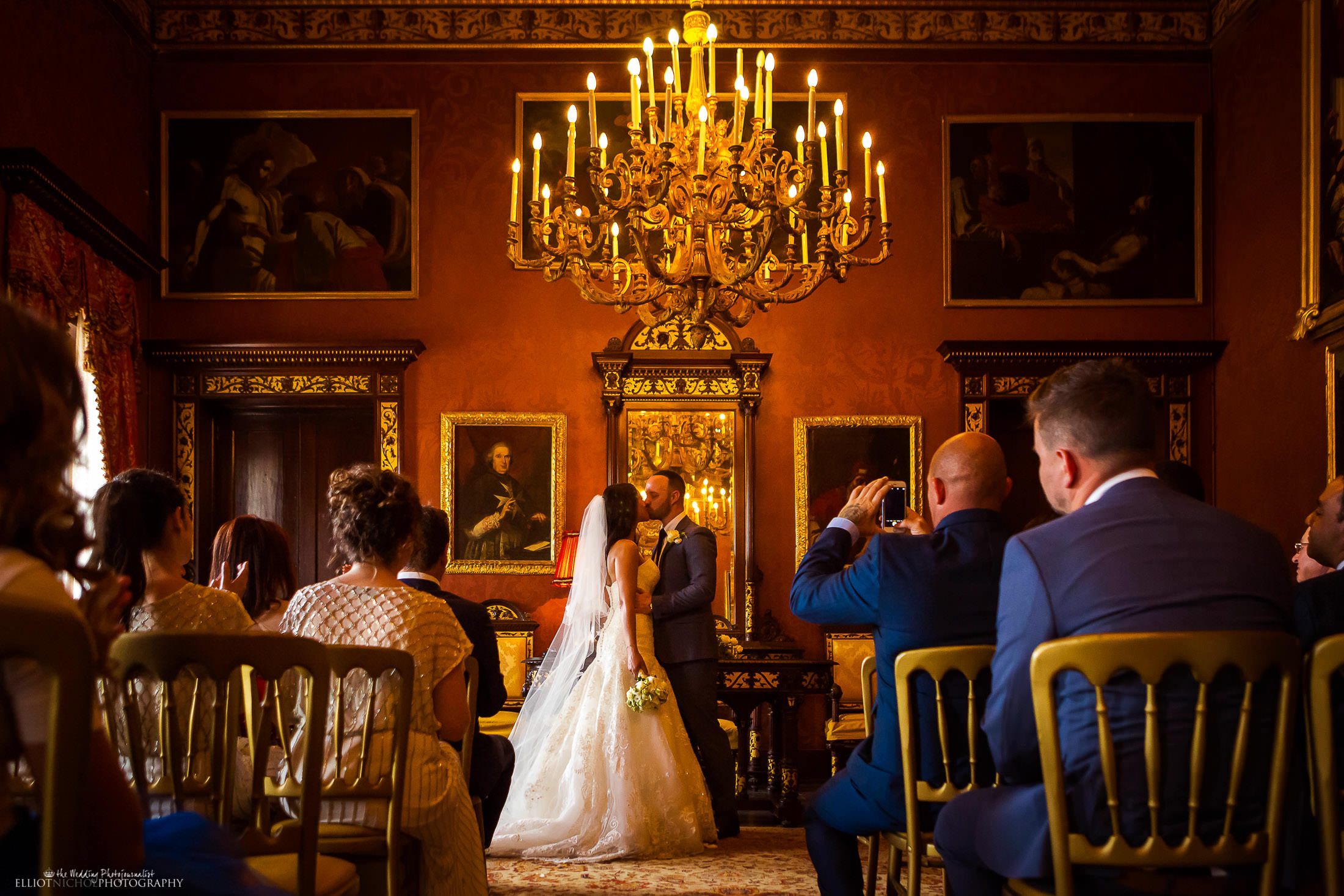 Bride and groom kiss after exchanging their wedding vows and rings. Photo by North East wedding photojournalist, Elliot Nichol Photography.