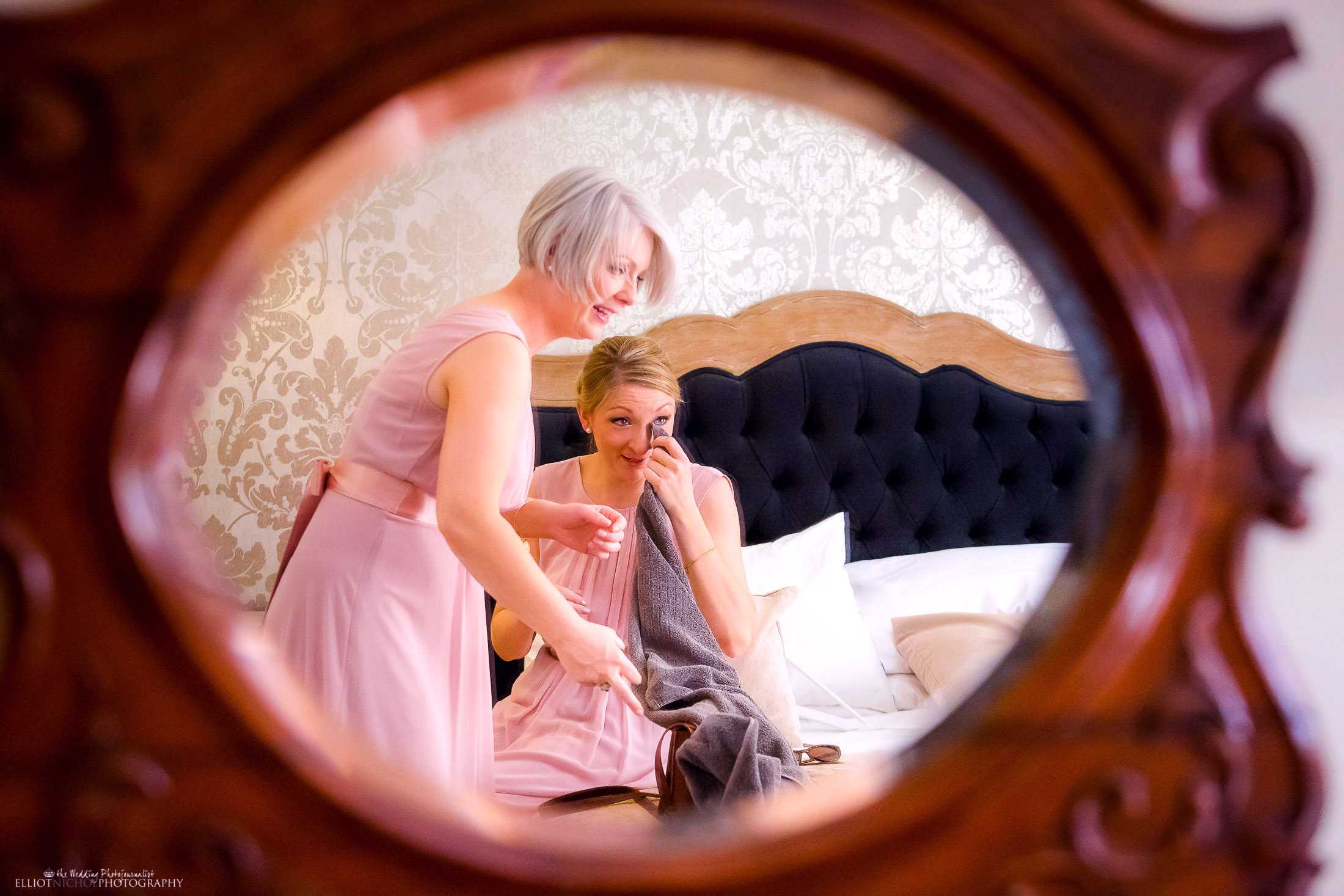 Bridesmaid get emotional after seeing the bride in her wedding dress. Photo by Elliot Nichol Photography.