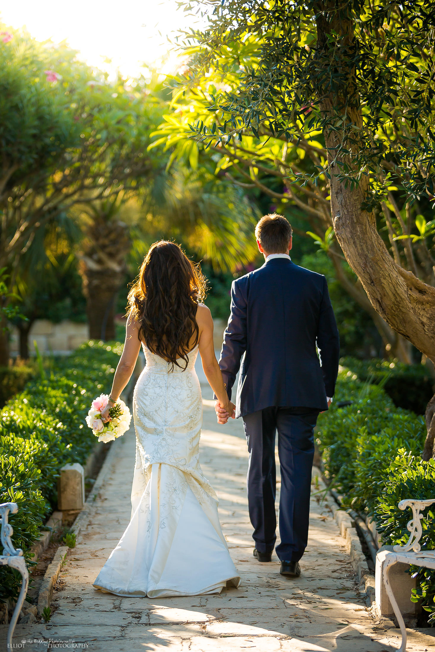 Bride and groom walk off together in the gardens of their wedding venue. Photo by Elliot NIchol Photography. www.elliotnicholphoto.com