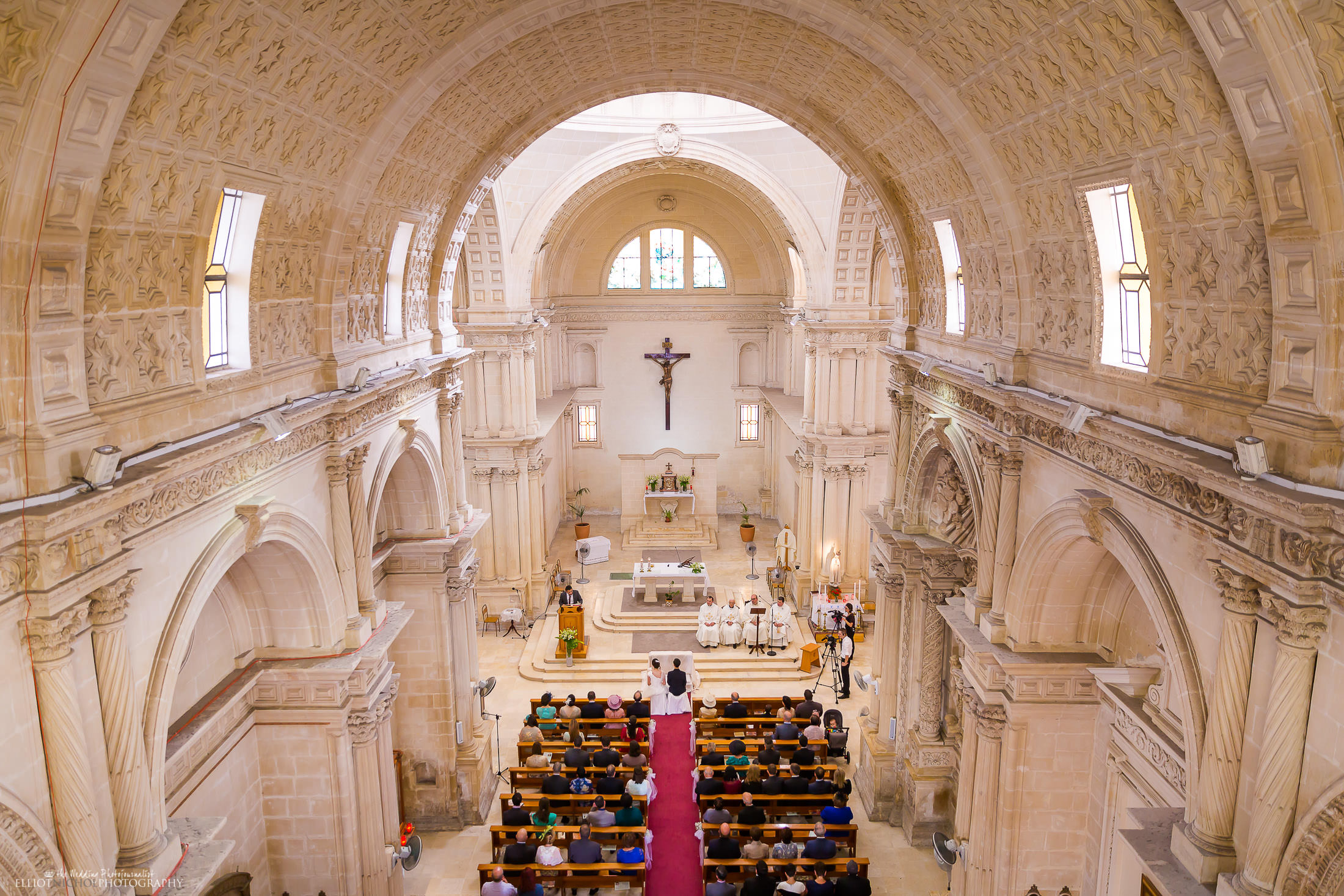 Overview of the church wedding ceremony. Photo by Elliot Nichol Photography.
