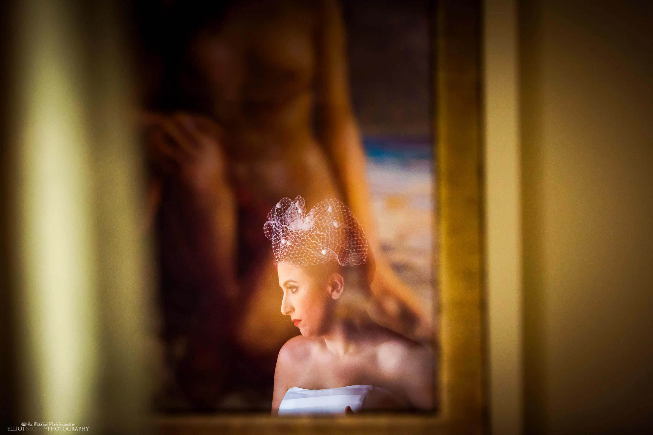 Reflection of bride in framed painting. Photo by Elliot Nichol Photography.