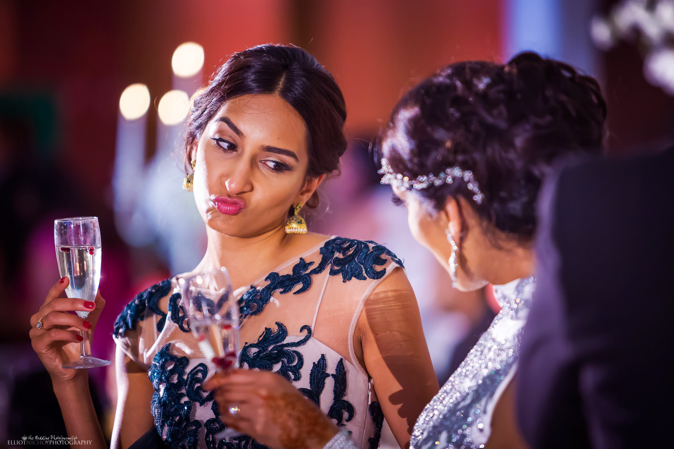 Bride and her sister having fun together during the wedding reception. Photo by Elliot Nichol Photography.